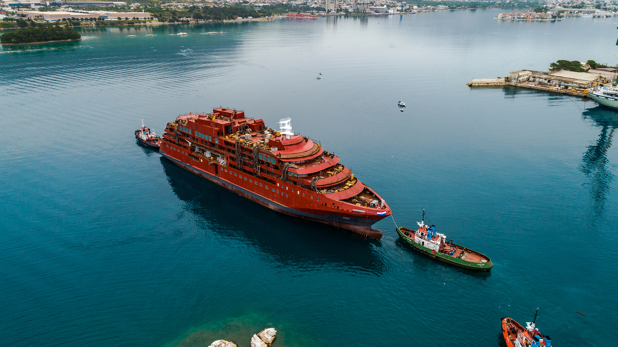 Aerial photo of Ultramarine in the water after its launch from slipway in Split, Croatia.