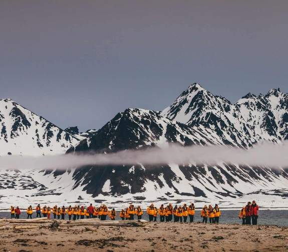 Passengers hiking in the Arctic